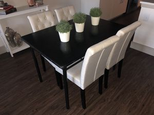 Black dining table and white tuffed dining chairs - has to go by 10/18 for Sale in Houston, TX