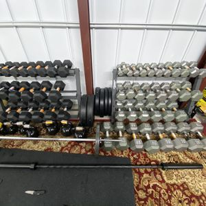 All Weights In Cast Iron Bumper Plates Standard Olympic Rubber Hex Dumbbells Sets Curl Bar Handles Rack for Sale in Houston, TX