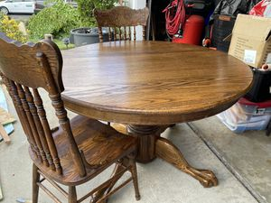 Beautiful round real solid wood table and 4 chairs for Sale in Whittier, CA