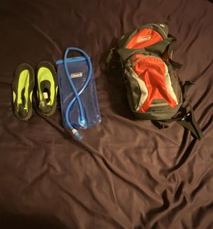 Hiking backpack with liquid pouch and water shoes for Sale in Kaysville, UT