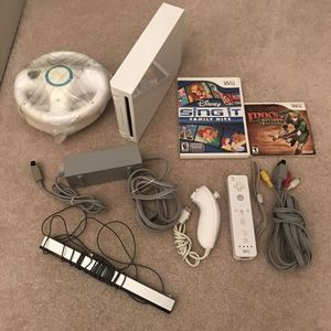 Nintendo Wii system console with controller nunchuk cables with 2 video games 2 steering wheels for Sale in Burtonsville, MD