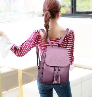 Super cute women's backpack with tassels and side phone pocket for Sale in Atlanta, GA