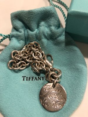 Like NEW Tiffany & Co. Circle Notes New York Round Tag Bracelet, for Sale in Englewood, CO