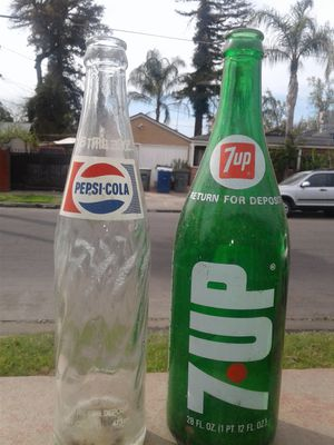 Collectible 7up and Pepsi bottles about 6 or more of each? for Sale in Fresno, CA