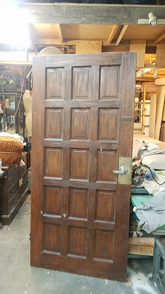 Solid door with panels