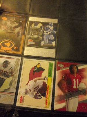 Larry Fitzgerald Eli Manning priest Holmes jersey card and many more collectibles for Sale in Kansas City, MO