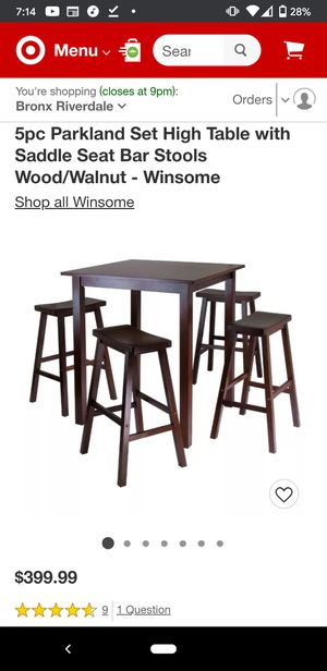Bar height table set with four saddle stools for Sale in The Bronx, NY