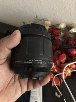 Tamron telephoto zoom lens's and canon battery for Sale in Tampa, FL