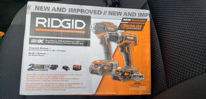 Ridgid combo drill/impact driver 2 batterys charger and bag for Sale in Katy, TX
