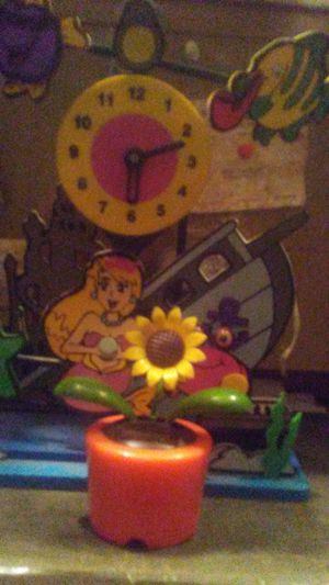 Colorful mermaid clock with rocking flower plant for Sale in Greenville, MS