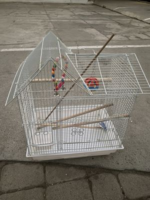 Bird cage with sticks and new toys for Sale in Los Angeles, CA
