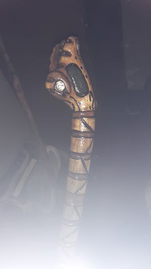 hand made one of a kind cane very detailed holds 3 faces a tiger paw a giraffe and a snake with his mouth open very unique for Sale in Montgomery, AL