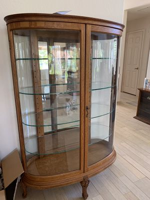 Curved glass antique oak curio cabinet for Sale in Carlsbad, CA