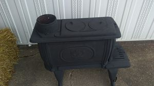 smoking stove nice garage for winter it works great for Sale in Evansville, IN