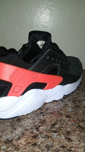 Kids orange and white Nike Huaraches. Boy's size 5.5 youth for Sale in Manheim, PA