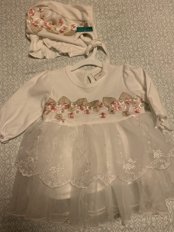 Baby's white dress with hat