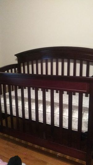 Cherry wood baby crib for Sale in St. Louis, MO