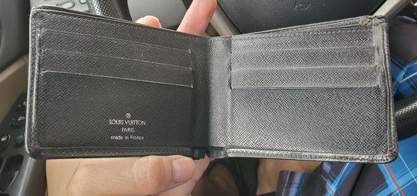 Louis vuitton men wallet- authentic code inside
