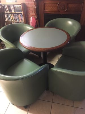Four Retro Lounge Chairs with Table made by Loewenstein for Sale in Arnold, MO