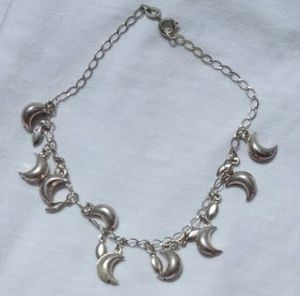 Lovely White Gold Color Crescent Moon and Star Charms Bracelet Stamped 18k for Sale in San Diego, CA