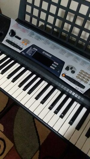 (LIKE NEW) YAMAHA EZ-150 PORTABLE ELECTRONIC KEYBOARD/PIANO/ORGANS WITH STAND AND POWER ADAPTER, ASKING $275 for Sale in Fort Wayne, IN