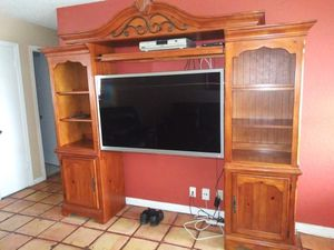 3pc wood wall unit and 55 inch tv 200 takes both . TV lights flick a little not bad but can be fixed. for Sale in Margate, FL
