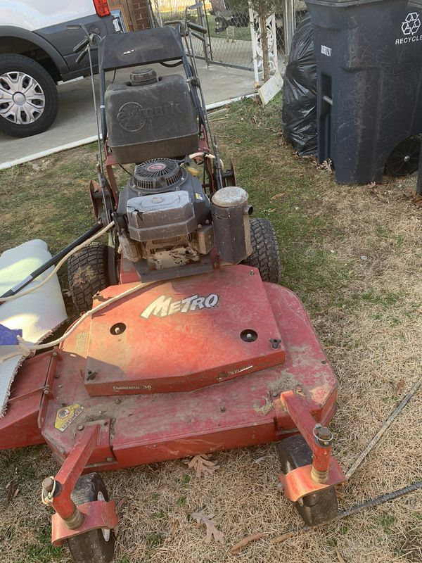 2 lawn mowers one 36