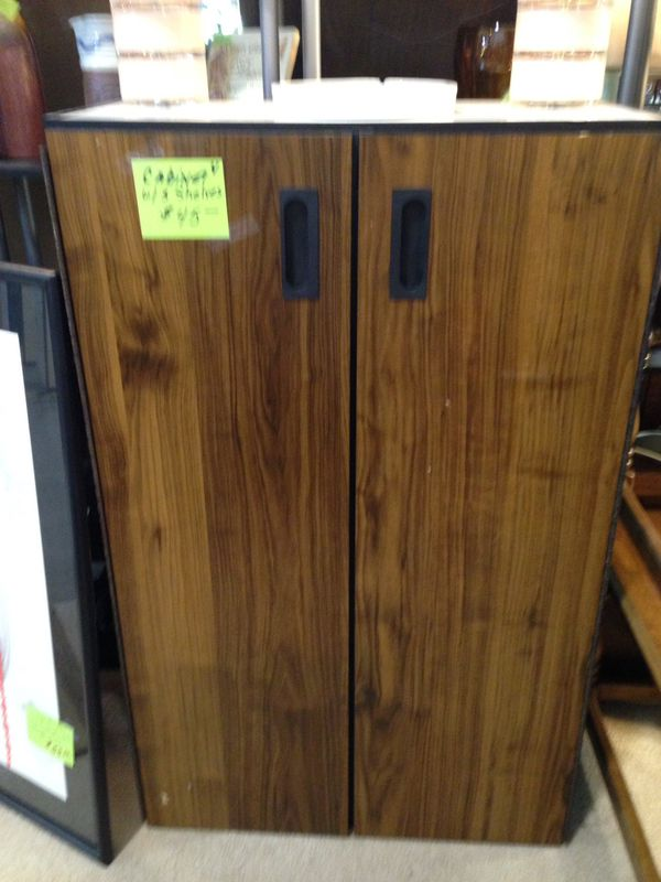 4 foot tall storage cabinet has three shelves inside scroll down for more information