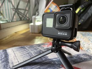 Selling GoPro 7 with 4 batteries, a duo charger, and a portable handy tripod for Sale in New York, NY