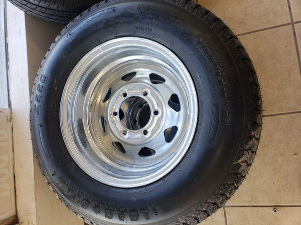 Set on 2- 225/75D15 Loadstar tire with galvanized rims