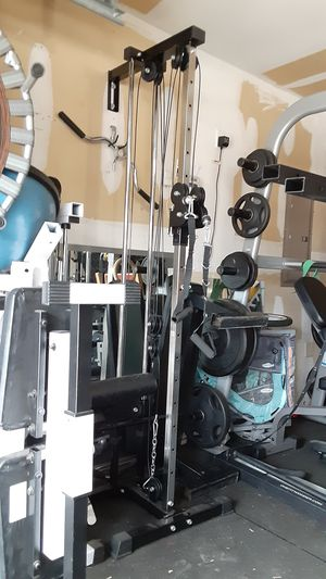Titan walmount cable machine missing bushings shown on pics for Sale in Saginaw, TX