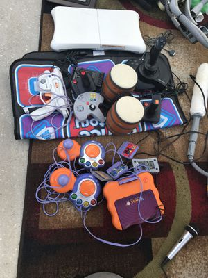 A game system and game Accessories for Sale in Tampa, FL
