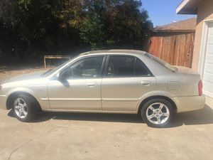 2003 Mazda protege, runs good and gas saver! for Sale in Fresno, CA