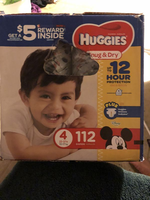 huggies sung and dry diapers size 4, 112 diapers, new box not open ,
