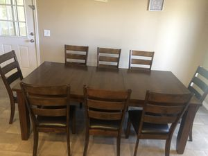 Dark solid wood table with 8 chairs for Sale in Phoenix, AZ