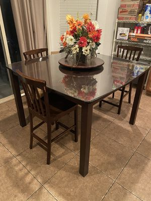 Kitchen table with custom glass top and lazy susan. for Sale in Las Vegas, NV