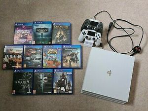 Ps4 Pro White 1TB 2 wireless controllers 10 games plus controller charger for Sale in Arlington, VA
