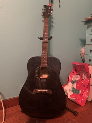 First Act Acoustic Guitar and Stand That's With it. for Sale in Paducah, KY