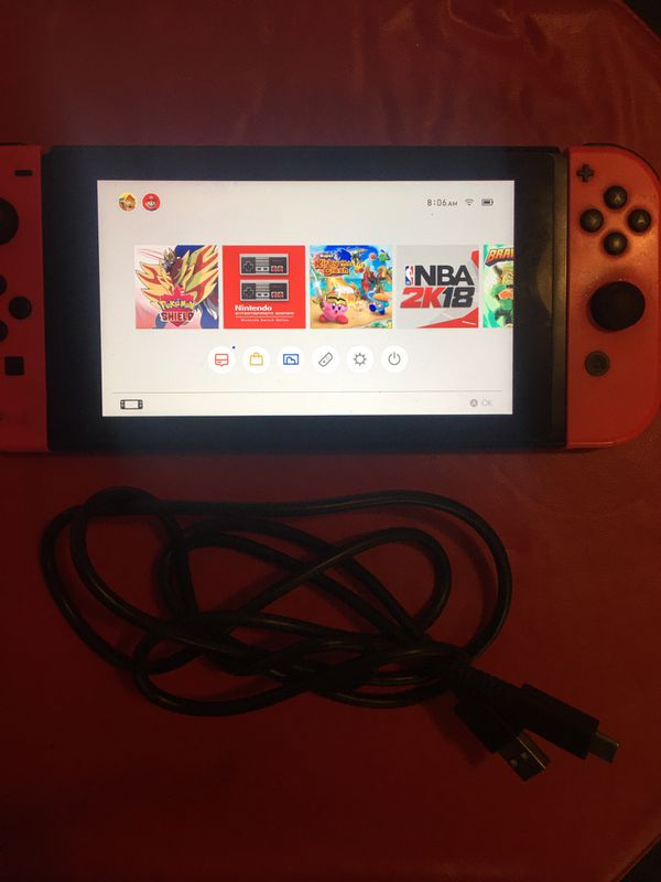 Newer Nintendo Switch With JoyCons and 10 preinstalled games (Pokemon shield not included)