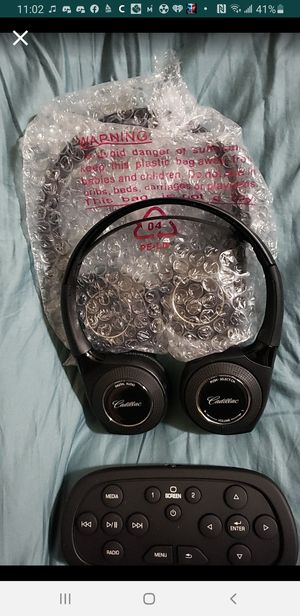 Oem Cadillac bluetooth headphones and remote for Sale in Seattle, WA