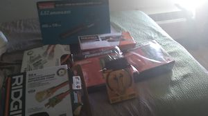 Ridged 2 50' 10gauge extension cords,Dewalt headphones wireless Ridgid heavy duty belt sander,2 chainsaw pair safety chaps,1 Makitablowerh for Sale in Plano, TX