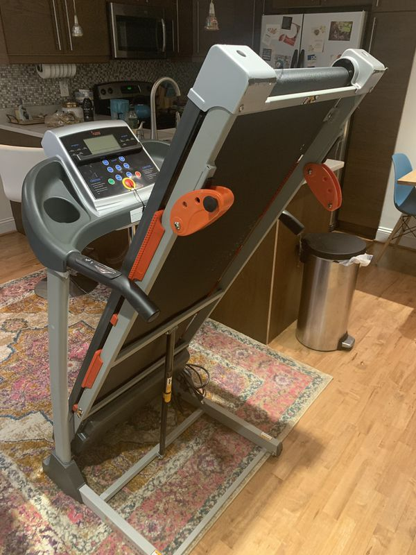 New barely used Sunny Health and Fitness folding treadmill