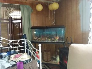 55 gallon fish tank and metal cast iron stand pump heater undergravel filter lights come with for Sale in Hamilton, IL