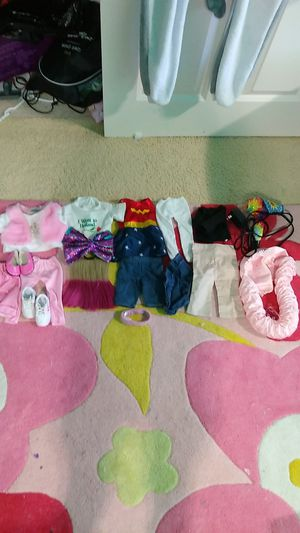 Doll clothes lot American girl and others also shoes and bow and tow other things look at photos blow drier never used , read the description for Sale in Portland, OR