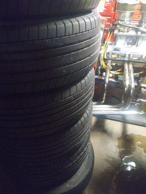 Cadillac rims and tires 225/55/zr16 for Sale in Arvada, CO