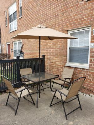 Outdoor Table with umbrella and 4 chairs for Sale in Fairfax, VA