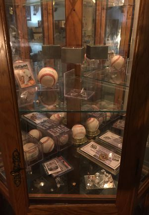 Beautiful Curio cabinet huge in size compared to most corner cabinets 123 for a triangular large glass shelves a bottom wood shelf lighting as excell for Sale in Warren, MI