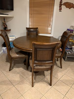 "Kitchen table 54"" round with 4 covered chairs. for Sale in Valley Stream, NY"
