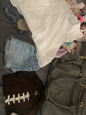Steve madden diaper bag bundle full of like new name brand toddler clothes all clothes are 12-18 months for Sale in Victorville, CA