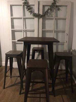 Heavy wood and wrought iron excellent condition pub dining room table and 4 bar stool chairs for Sale in Lodi, CA